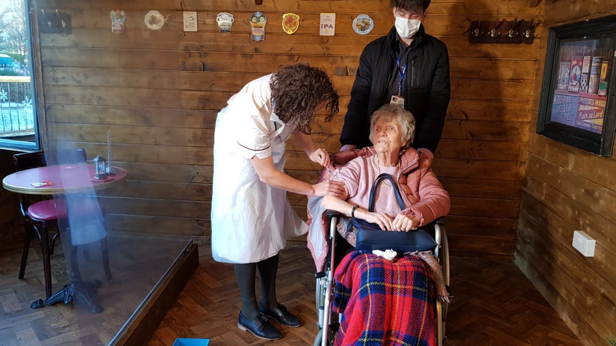 83 year old June Phelps from Sutton Manor Residential Home is more than happy to get her vaccine